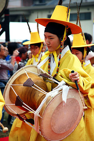 Janggu - A performer playing janggu