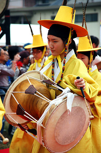 Janggu - A performer playing janggu