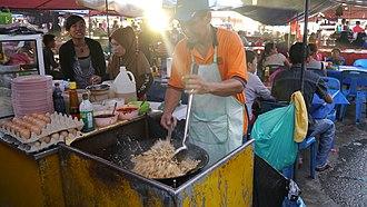 Nasi goreng - A cook making nasi goreng in a food market in Kota Kinabalu, Sabah.