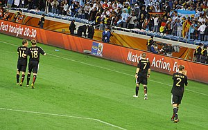 Marcell Jansen - Jansen (wearing 2) claaping his hand after beating Argentina in the quarter–final of the World Cup.