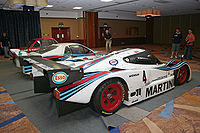 https://upload.wikimedia.org/wikipedia/commons/thumb/6/62/Lancia_LC2_Rear.jpg/200px-Lancia_LC2_Rear.jpg