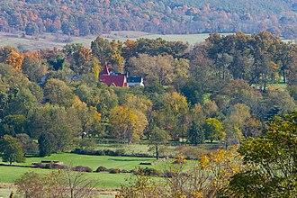 Paris, Virginia - Paris in autumn (Trinity United Methodist Church with Ashby Inn behind it)