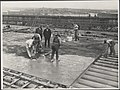Laying of the surface of the roadway of bridge, 1931 (8282717831).jpg