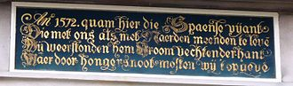 "Schutterij - Above the door: ""In 1572 the Spanish enemy came here to treat us the same way as Naarden. We withstood him, fighting bravely, but from hunger we had to give up."""