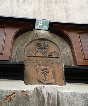 Wolfgang Bosch - The plaque with the coat of arms of Wolfgang Bosch at Fish Square in Ljubljana