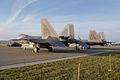 Lockheed-Martin F-22A-30-LM Raptors 05 107 and 05-099 LSideRears Dawn SNF 04April2014 (14563316406).jpg