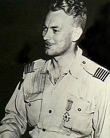 Informal half-portrait of blond man in light-coloured military uniform