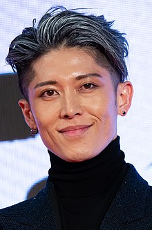 "MIYAVI from ""American Airlines"" at Opening Ceremony of the Tokyo International Film Festival 2019 (49013892946) (cropped).jpg"