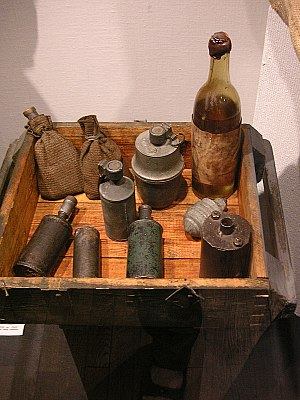 Satchel charge - Two improvised satchel charges along with Sidolówka grenades and a Molotov cocktail, as used in the Warsaw Uprising.