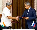 Manohar Parrikar and his Russian counterpart General Sergey Shoigu exchanging the protocol document after the 16th meeting of the India-Russia Intergovernmental Commission on Military-Technical Cooperation (IRIGC-MTC).jpg