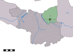 The village centre (dark green) and the statistical district (light green) of Zaamslag in the municipality of Terneuzen.