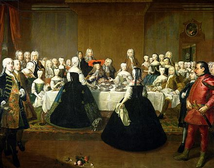 Maria Theresa and Francis Stephen at their wedding breakfast, by Martin van Meytens. Charles VI (in the red-plumed hat) is seated at the center of the table. Maria Theresa and Francis Wedding Breakfast by Martin van Meytens ca 1736.jpg