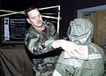 Master Sgt. Paul Plas, 2nd Civil Engineering Squadron, sponges off an airman's Chemical Warfare Ensemble at the Mask Wipe and Hook Removal Station during Chemical Warfare Training, March 1, 2002, at Barksdale 020301-F-JG870-014.jpg