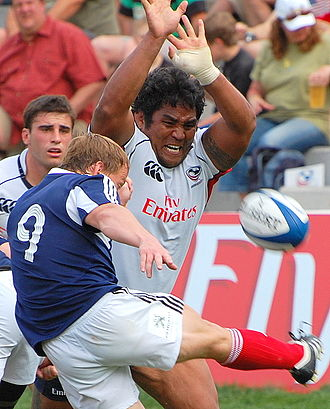 Rugby union gameplay - A player attempting to charge down a kick
