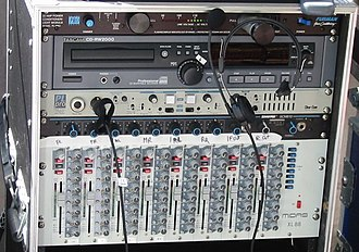 Midas Consoles - A 19-inch rack holding several professional audio devices including a Midas XL88 8×8 matrix mixer at the bottom