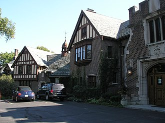Forest Preserve District of DuPage County - The front façade of Mayslake Hall, constructed in the Tudor Revival style in Oak Brook, Illinois.