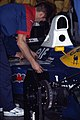 Mechanic working on Nigel Mansell's car 1991 Phoenix.jpg