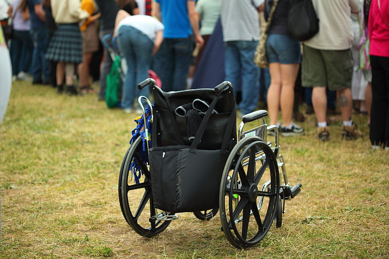 File:Medieval Renaissance Fair Crowd and Empty Wheelchair (5722826436).jpg