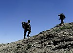 Members of the 439th Air Expeditionary Advisory Sq and Afghan Air Force patrol outside Kabul.jpg