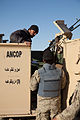 Members of the Afghan National Civil Order Police prepare for a patrol with U.S. Soldiers in the Maiwand district, Kandahar province, Afghanistan, Feb 120225-A-QD683-102.jpg