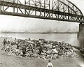 Men going through a rubbish pile on the riverfront south of Municipal (MacArthur) Bridge.jpg