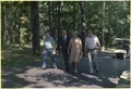Menahem Begin and Mrs. Begin stroll with members of the Israeli delegation at Camp David. - NARA - 181190.tif