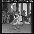 Mexican American girl in costume dancing with mariachi band at opening of Good Neighbor Week in Los Angeles, Calif., 1964.jpg