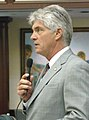 Michael Grant seeks support for a measure on the House floor.jpg