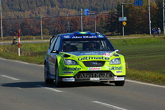Rally Japan - Mikko Hirvonen during a road section of the 2007 Rally Japan.