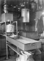 Milk cooler on Aplin's farm, Silverstream, circa 1921. ATLIB 288204.png