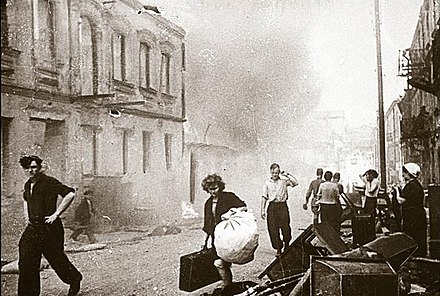 Civilians carry belongings out of burning houses, early July 1944 Minsk civilians return home 1944.jpg
