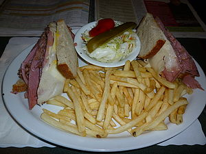 Montreal-style smoked meat - Smoked meat sandwich, served with coleslaw, french fries and one quarter of a pickle