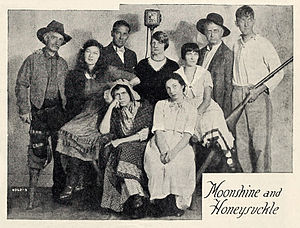 Claude Cooper (actor) - Cast of the NBC radio series Moonshine and Honeysuckle, 1931. From left to right: Claude Cooper, Ann Elstner, Gerald Stopp (NBC Production Manager), Lula Vollmer, Jeannie Begg, John Milton, Louis Mason; (seated) Ann Sutherland and Sara Haden.