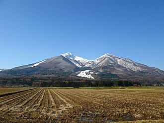 Mount Bandai - Mount Bandai rises above rice fields.