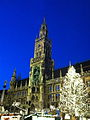 Munich City Hall at night with Christmas Tree and Christmas market booths.jpg