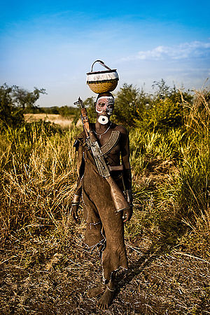 Endemic warfare - An armed woman of the Mursi tribe of Ethiopia