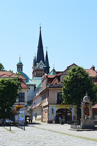Myślenice - Market square and the Church of the Birth of Virgin Mary in Myślenice