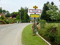 Nédon (Pas-de-Calais) city limit sign and Nave river.JPG