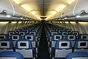 The interior of a Delta Air Lines Boeing 737-800 with in-flight entertainment and slimline seats.