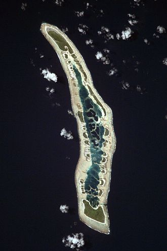 Caroline Island - NASA orbital photo of Caroline Island; north is to the upper right. The two largest islets are Nake Islet (top) and South Islet (bottom) and are about 500 m wide.