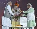 Narendra Modi being presented a memento by the Governor of Haryana, Prof. Kaptan Singh Solanki and the Chief Minister of Haryana, Shri Manohar Lal Khattar, at Haryana Swarna Jayanti Celebrations, in Gurugram, Haryana.jpg