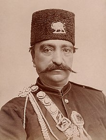 Naser al-Din Shah Qajar, close up, with slight smile by Nadar.jpg