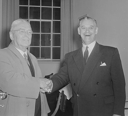 Holyoake (right) congratulating Walter Nash on Labour's victory in the 1957 election Nash & Holyoake 1957.jpg