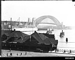 Nearly completed Sydney Harbour Bridge with SS MARIPOSA, February 1932 (7560228896).jpg