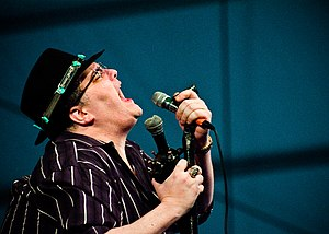 John Popper - Popper's trademark hat and custom modified harmonica microphone