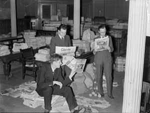 Padlock Law - Men reading confiscated literature in Montreal City Hall, 1938