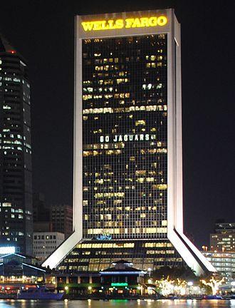 "History of the Jacksonville Jaguars - Wells Fargo Center with their ""Go Jaguars"" lighting for the 2011 Jacksonville Jaguars season"