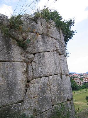 Norba - A detail of the polygonal masonry bastion flanking the Porta Maggiore.