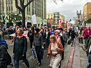 An image of protestors marching down a street in Oakland.