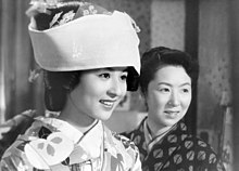 A photo of Kyoko Kagawa in a fancy traditional dress, next to another woman.